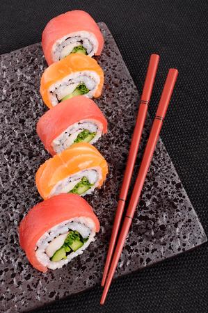 Salmon & tuna sushi roll on a plate