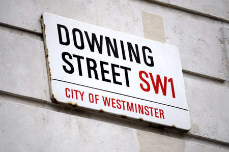 england politics: Street sign of Downing street in London Stock Photo