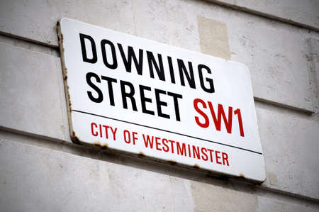 english famous: Street sign of Downing street in London Stock Photo
