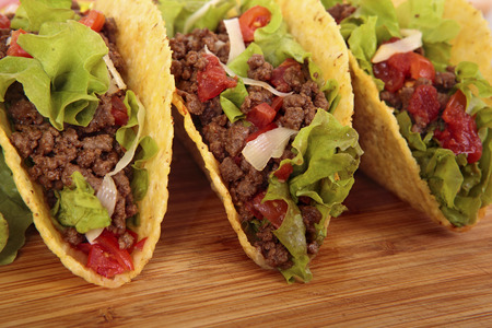 Mexican beef tacos on wooden table Stok Fotoğraf