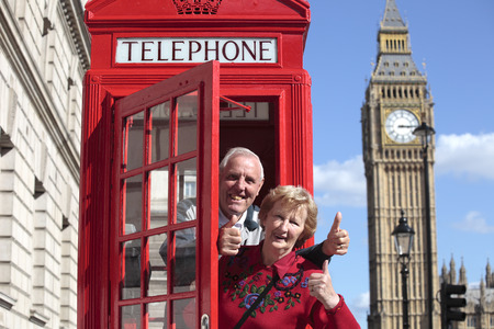 Senior couple with red telephone box in London. Big Ben in the background. Stock Photo