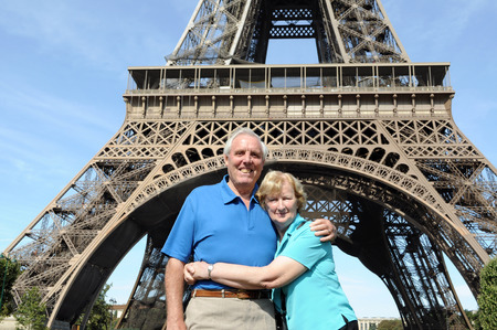 Senior couple enjoying their vacation in front of Eiffel Tower in Paris