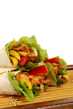 fajita: Fajita wrap sandwich with griddled chicken and salad