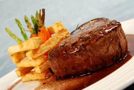 Fillet of beef with rosemary, wine sauce, thick cut fries and vegetables