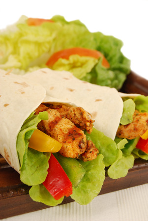 Fajita wrap sandwich with griddled chicken and salad photo