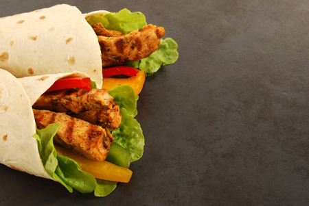Fajita wrap sandwich with griddled chicken and salad
