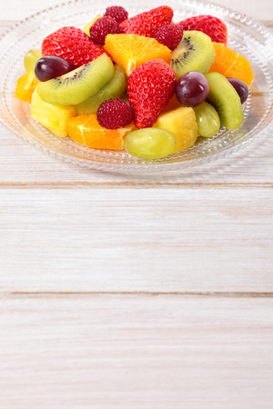 Fruit salad mixed fresh fruits with copyspace photo