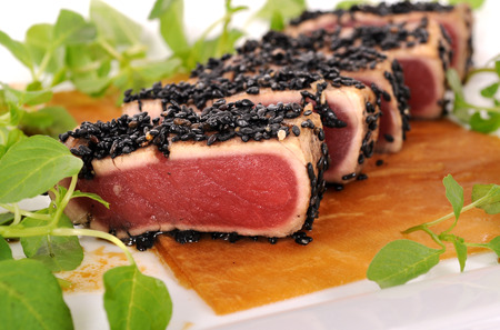 ahi: Seared tuna coated sesame seeds with green salad on marinated Chinese radish