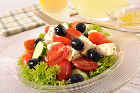 glass bowl: Greek salad in glass bowl with lemon juice