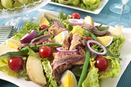 potato tuna: Nicoise salad arranged on table Stock Photo