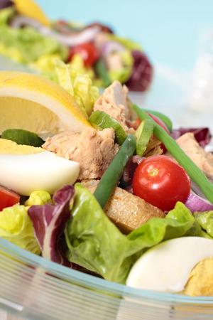 glass bowl: Salad Nicoise in glass bowl closeup Stock Photo