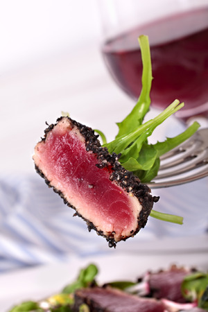 ahi: Seared Ahi tuna coated with sesame seeds on fork Stock Photo