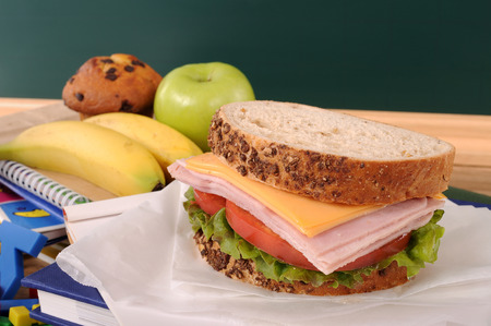 School lunch with blackboard in classroom Stock Photo