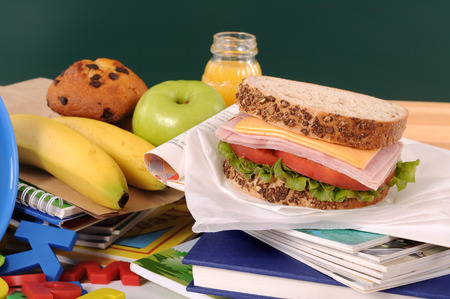 lunch: School lunch on a classroom desk Stock Photo