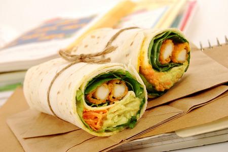 School lunch of fried chicken & avocado wrap sandwich Stock Photo