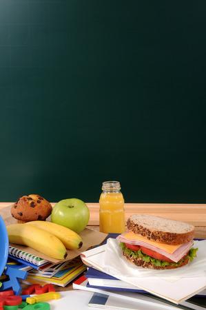 School lunch on a classroom desk with blackboard