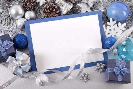 blue gift box: Blank Christmas card or invitation with blue envelope surrounded by decorations. Space for copy.