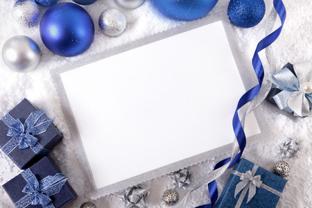 blue border: Blank Christmas card or invitation surrounded by ribbons and decorations. Space for copy. Stock Photo