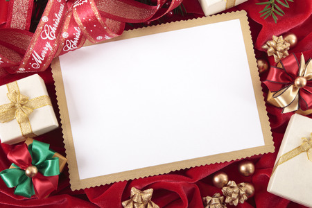Blank Christmas card or invitation surrounded by ribbons and gift boxes. Space for copy. Stock fotó
