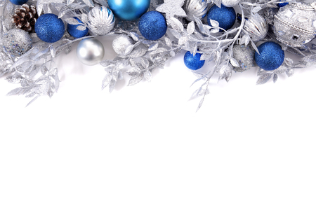 blue and white: Christmas border with traditional decorations. Space for copy.