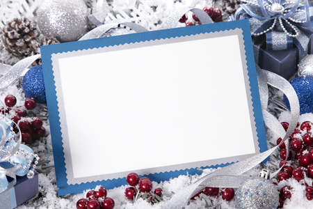 photo backgrounds: Blank Christmas card or invitation with blue envelope surrounded by decorations. Space for copy.