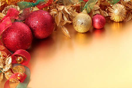Christmas border with red and golden decorations. Space for copy.