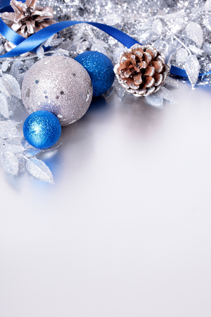 Christmas border with silver and blue decoration. Space for copy.