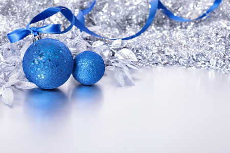 blue border: Christmas border with blue balls and ribbon. Space for copy.