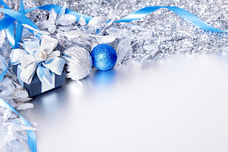blue gift box: Christmas border with gift box and balls. Space for copy.