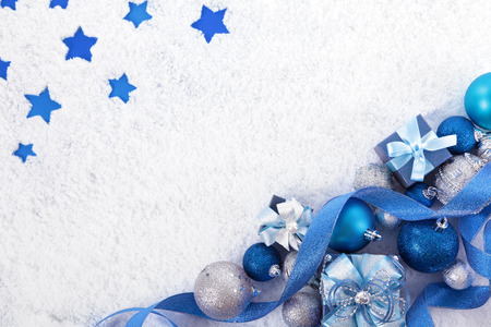 blue gift box: Christmas border with traditional decorations on the snow. Space for copy.