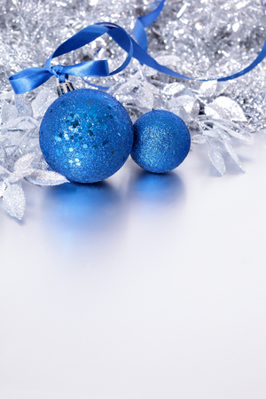 Christmas border with blue balls and ribbon. Space for copy.