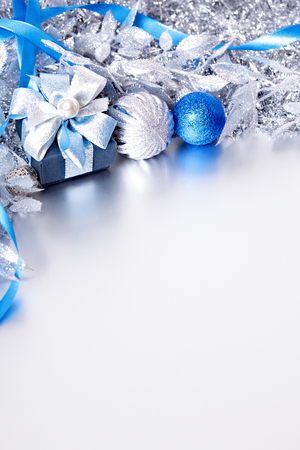 silver reflection: Christmas border with gift box and balls. Space for copy