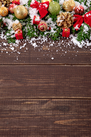 copyspace: Christmas tree decoration border on wood background with copyspace Stock Photo