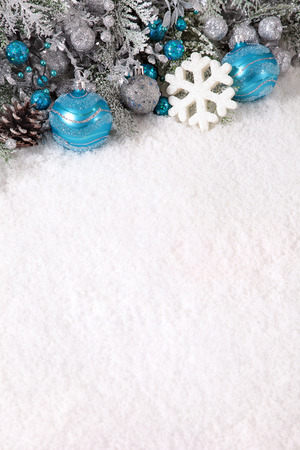 space for copy: Christmas border with decorations on the snow. Space for copy.