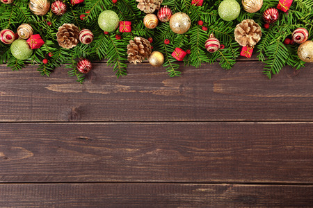 christmas bauble: Christmas decoration border on wooden background with copy space