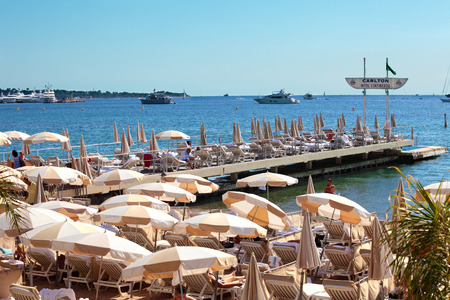 holiday movies: Private beachfront with parasols in Cannes, France Editorial