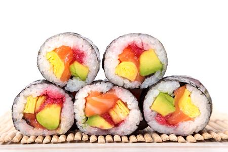 maki sushi: Stack of maki sushi on white background Stock Photo