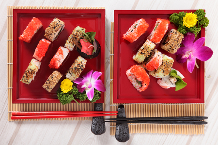 california roll: California roll sushi displayed on tray with chopsticks