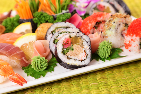 assorted: Assorted sushi selection on bamboo mat
