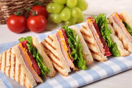 Summer picnic club sandwich ham and cheese in a row