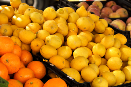 Fresh lemons and oranges on market stall in southern Spain