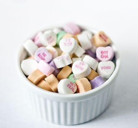 White bowl with conversation heart candies