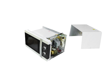 Isolated Broken microwave oven on white