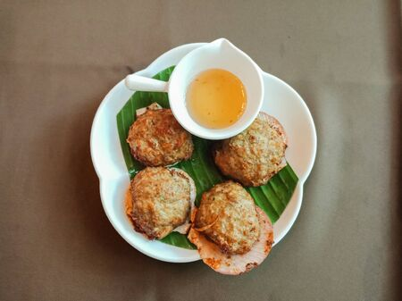 Top view, Thai Fried Crab meat ball on green banana leaf