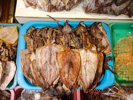 Group of Dry squid in blue basket, Thai food, Top view