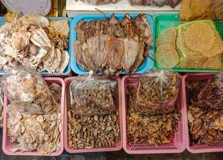 Group of Dry squid in plastic basket, Thai food, Top view