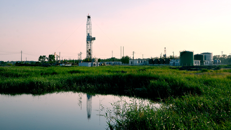 Drilling rigs with industrial tanks