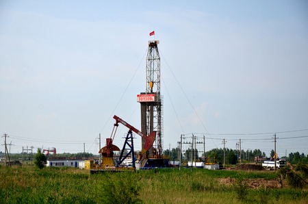 Drilling rigs and oil derrick in an area Editorial