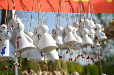 Sun doll wind chimes on display Stock Photo - 94109506