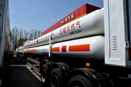 Oil tanker trucks carrying natural gas